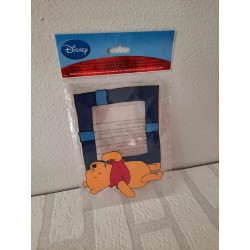 Money box in a shape of an elephant with dungarees