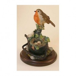 Redbreast with nest of eggs in teapot on a wooden plateau The Leonardo collection