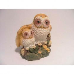 Owl with young under the wing of synthetic resin