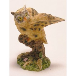 Owl with open wings of synthetic resin