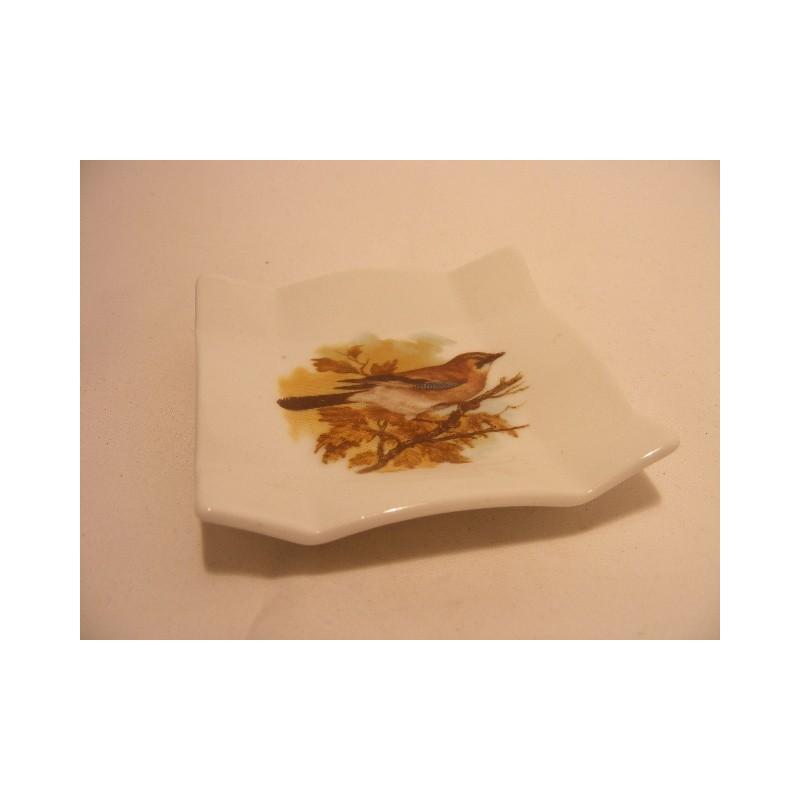 Vierkant schaaltje van porselein voor je theezakje, amuse, bonbon enz met een vogel afbeelding