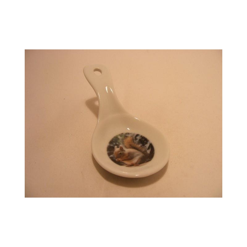 Lepel vorm schaaltje van porselein voor je theezakje, amuse met een eekhoorn afbeelding