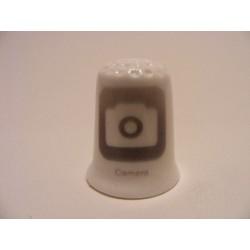 Apple icoon camera afbeelding op een porselein vingerhoedje