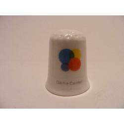 Apple icoon game center afbeelding op een porselein vingerhoedje
